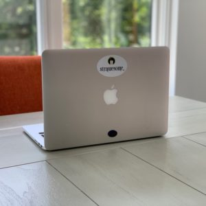 Mac book with Strawesome sticker